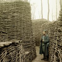Austrian soldier in a trench on the eastern front, which has been secured with fascines (rough bundle of brushwood), Russia. Photo Hans Hildebrand, 1915. Collection Galerie Bilderwelt / The Bridgeman Art Library